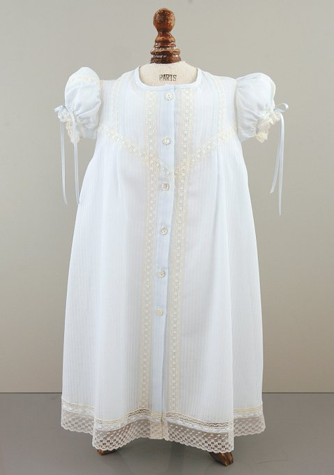Light blue Christening gown with six-buttons down the front, lace inserts,  and puff sleeves.