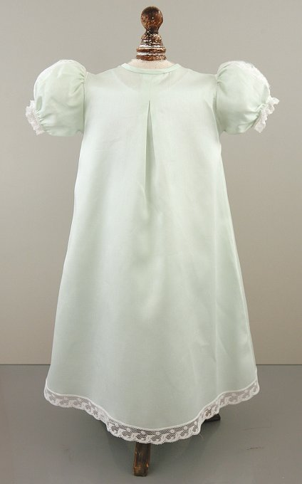 Lacey, five-button Christening gown with puff sleeves, intricate embroidery, and a beautiful lace yoke.