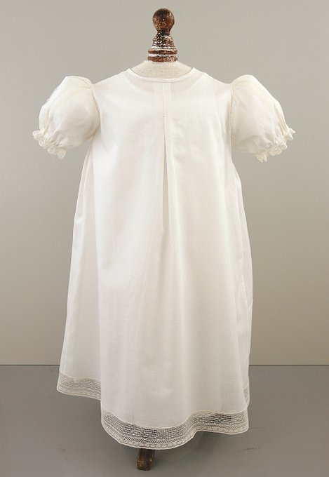 White Christening gown with six-buttons down the front, lace inserts, and puff sleeves,.