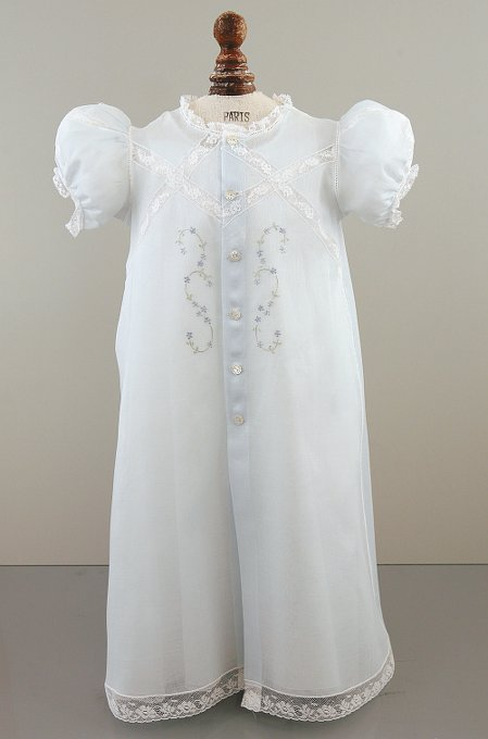 Light blue Christening gown with five pearlescent buttons down the front, lace inserts in an