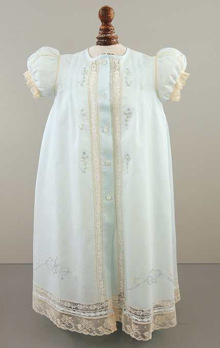 Light blue Christening gown with five pearlescent buttons down the front, lace inserts along the buttons, and puff sleeves.